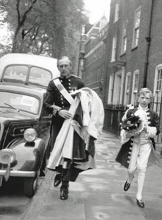 The Earl of Home hurrying along Great College Street together with his page who I believe is his only son David Douglas-Home now the 15th Earl Home. They have an appointment at Westminster Abbey for the Coronation of Queen Elizabeth II on 2nd June, 1953 B. Lowe
