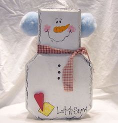 cutest snowman made from a paver used as a door stop!