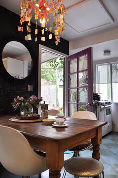 kitchens, doors, chalkboards, modern chairs, black walls, chalkboard walls, purple, rustic table, dark wall