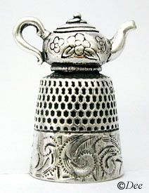 Teapot Thimble - cute, but you would have a hard time using it as a thimble...unless the teapot is not attached...