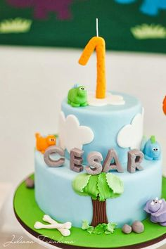 Such a cute cake at a Dinosaur Themed 1st Birthday Party with Lots of Cute Ideas via Kara's Party Ideas | KarasPartyIdeas.com #Dino #DinosaurParty #PartyIdeas #PartySupplies #cake