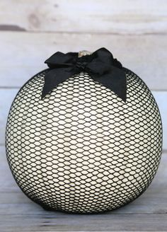 Pumpkin -white pumpkin, fishnet and a black bow.  Simple and beautiful for Halloween!