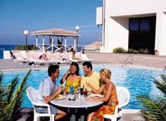 Dining with friends, poolside