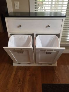 Make your own DIY garbage and recycling center. Elegant styling, no ugly garbage cans and extra storage in the kitchen #DIY #Garbage #Hack #Eyesore #Fix #Wood #DIYrecyclingbin