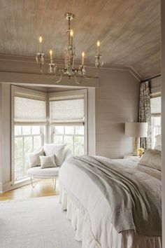 exposed wood on ceiling. rustic chic bedroom.