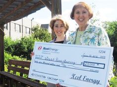 Our neighbors at Great River Greening got a big check!
