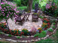 surround flower, circular patio with flowers, long border, circular patios, circular flower beds, beauti garden, spring patio, flowers beds
