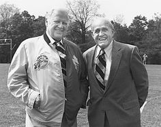 Harold Ballard, sporting a half Hamilton Tiger-Cats, half Toronto Maple Leafs jacket, with King Clancy on the campus of Brock University