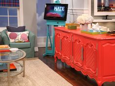 i love the idea of a flat screen in an easel! not to mention the color of that hutch....so awesome.