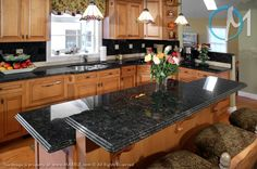 Butterfly Antique Granite in Kitchen photo gallery.