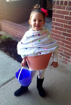 Little Girls #DIY Cupcake Halloween Costume :-) All u need is a lampshade, old towel, some .99 colorful cotton balls, hot glue gun & a few safety pins... Simple & cheap, yet so cute.