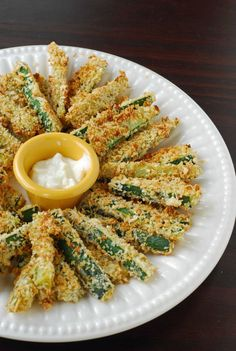 zuchinni fries : not fried but baked. baking in high temperature, roll them twice, first in flour, and then in panko made them crispy in the outside, while the inside were still tender.