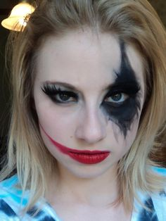 Modern Harley Quinn makeup, i would do another smudged diamond on the other eye as well as make the lips more blood-drippy < a thought