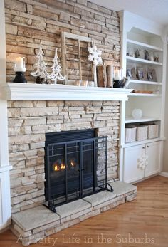 Stone for fireplace. Then I'm thinking floating shelves on both sides if fire place. A place for the TV and two storage cabinets are both sides for balance.