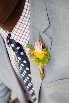 bright boutonniere + plka dot tie // photo by Sweet Monday Photography, flowers by Peacock Blooms Floral Design // View more: http://ruffledblog.com/late-summer-citrus-inspiration/
