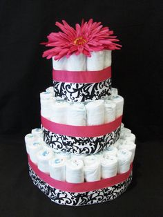 black damask baby shower cake - This one looks cool & like the diapers are actually useable - not terrible - otherwise I DESPISE diaper cakes/strollers/other concoctions made of disposable diapers - I am SOOO against the waste of disposables - plus you can't even use the diapers the cakes are made of? Wtf is the point then. Idk - they're just tacky - this one is cute though.