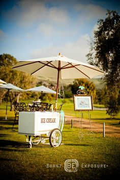Ice cream cart at a Summer wedding is charming and fun!