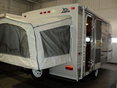 Went to the RV show yesterday with Riley and this was our fave, it's a little trailer but with a tent bed bump out :D