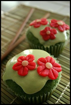 Vegan green tea cupcakes with almond flowers