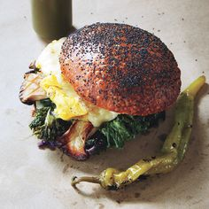 """Forager Sandwich // """"Acid and texture are the most important things,"""" says chef Eli Kulp, High Street on Market, Philadelphia. His hearty vegetarian breakfast sandwich—with its mix of marinated mushrooms, soft eggs, melted cheese, and a buttery toasted roll—proves his point."""