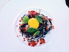 Squid pasta, crispy bacon, egg yolk and basil. Art on a plate...