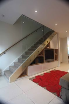 Detail 9 Architects - inner Melbourne suburb reno. Fantastic staircase featuring clever storage and gorgeous glass wall.