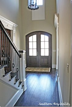 Love everything. The light, the door, the wood steps etc......ditch the floor plan though, entryways are overrated!