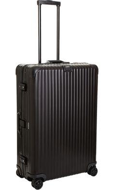 "Holiday Travel Essentials: RIMOWA  Topas Stealth Multiwheel® 32"""
