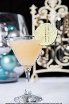 Citrus Edge with 1.5 oz. Smirnoff® Cinna-Sugar Twist™ Flavored Vodka, 1 oz. grapefruit juice, 0.5 oz. lime juice, and 0.5 oz. agave nectar. Add ingredients to an ice-filled shaker. Shake and strain into a martini glass. Garnish with a lime wheel. #Smirnoff #drink #recipe #holiday #gifts