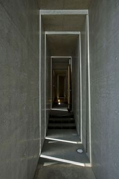 Japanese architects EASTERN design office completed a house with slits instead of windows in Shiga, Japan.