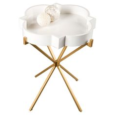 white and gold quatrefoil side table