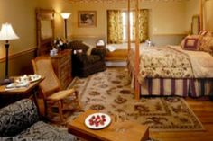 Room 14: Enhanced Traditional Guest Room located on the third floor with a queen bed, sitting area with a sofa, lake view Jacuzzi, and a private bathroom with a steam shower. $435.00 MAP, $395.00 B&B