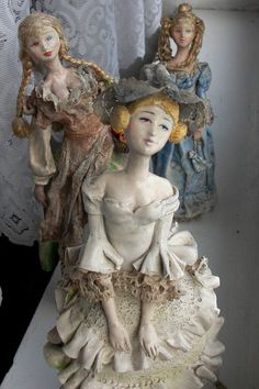 Dolls made of paper clay