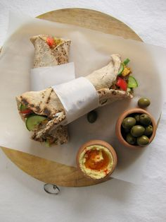 CHICKEN SHAWARMA. Chicken breasts- 2 medium sized  Onion (chopped)-1 no  Cucumber (chopped)-1/2 no  Tomato(chopped)-1 no  Lettuce(chopped)-1 cup  Pita bread -3 or 4 nos  Oil