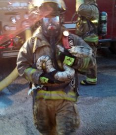 Firefighter rescues 6-foot python from Michigan blaze.  | Shared by LION