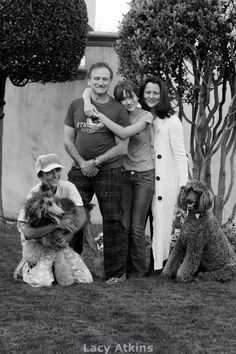 Robin Williams and family with two standard poodles. ummm yah poodles are awesome