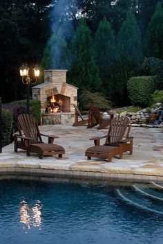 Green backyard and outdoor, stone fire place.