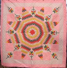 An original and unusual 1920's version of the Lone Star, with added Carolina Lily blocks. From the Lehigh Valley, PA, it measures about 78 x 79 inches, in excellent condition.