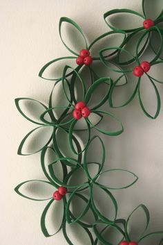 A festive holiday wreath made of toilet paper rolls- Crescent and Old Lace featured at Totally Green Crafts #recycled crafts