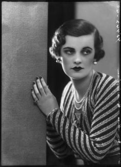 """Margaret Campbell, Duchess of Argyll. """"Always a poodle, only a poodle! That, and three strands of pearls! Together they are absolutely the essential things in life""""."""
