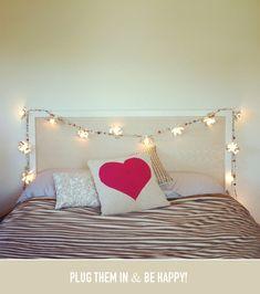diy cafe lights over the headboard diy room decor, hanging lights, headboard, christmas lights, string lights, dorm rooms, diy light, bedroom, tea lights