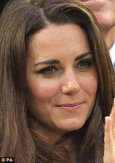 A watery-eyed Duchess of Cambridge looks on as an emotional Andy Murray loses at Wimbledon yesterday, while his girlfriend Kim Sears, right, bursts into sobse
