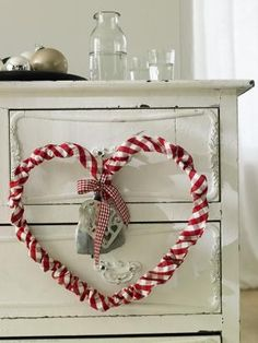 striped fabric casing around wire heart, holding a lavender sachet