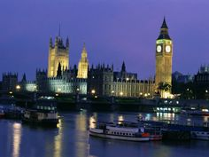 Parliament Square in London, England at night.