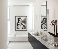 A Thom Jackson #photograph adds punch to this #Dallas master #bath's sleek finishes. See more at www.luxesource.com. #luxe #luxemag #luxury #design #interiordesign #interiors #home #house #dwelling #residential #decor #homedecor #interiordecorating #interiordesignideas #bathroom