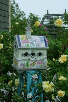 Beautifully painted birdhouse in the garden !!!