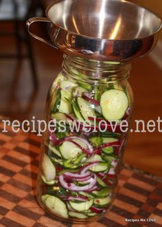 Refrigerator Cucumber Salad - delicious and can last up to 2 months! This is wonderful for a pot luck, picnic or cookout at the house.