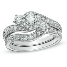 The coordinating contoured and diamond-lined wedding band fits snuggly beneath, completing the ensemble.