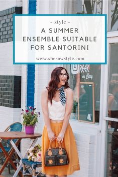 A Summer Ensemble Suitable for Santorini | She Saw Style #santorini #greece #yellowskirt #midiskirt #louisvuittonbag #vintagelouisvuitton #louisvuittonmanhattanpm #gingham #neckerchief #neckscarf #forever21 #summerstyle #summer #rva #vacationstyle #greecevacation #santorinitrip | girl stands in a mustard yellow midi skirt and cream camisole crop top with a navy gingham neckerchief holding a vintage louis vuitton manhattan pm handbag in front of a greek restaurant in richmond virginia