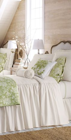 Mint green and white together; long gathered coverlet, sconces, natural rug - Legacy Home Hampton. Guest room